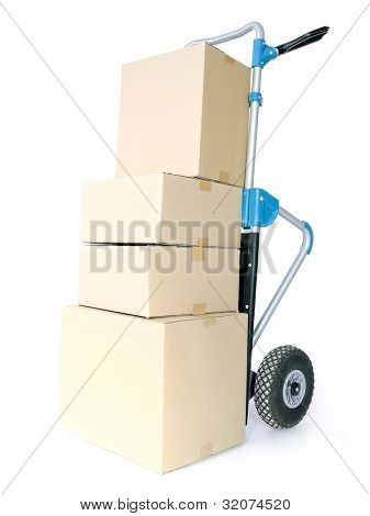Pile of cardboard parcels loaded on hand truck on white background