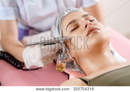 Cosmetology Beauty Clinic.professional Cosmetologist Conducts Cell Oxygenation For The Face Ozone Tr