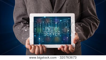Young business person working on tablet and shows the digital sign: PROXY SERVER