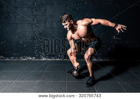 Kettlebell Training, Young Strong Sweaty Focused Fit Muscular Man With Big Muscles Holding Heavy Ket