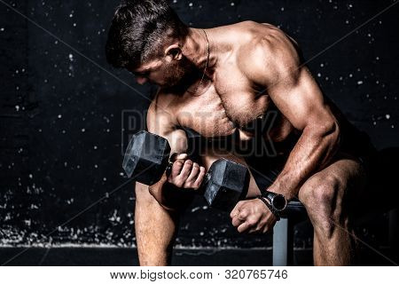 Biceps Training, Young Strong Muscular Sweaty Man Biceps Muscle Workout Training With Heavy Dumbbell