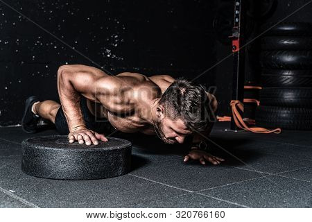 Push Ups Training, Young Strong Sweaty Focused Fit Muscular Man With Big Muscles Doing Push Ups With