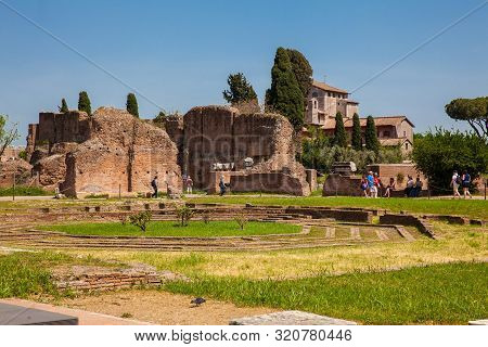 Rome, Italy - April, 2018: Tourists Visiting The Peristyle With Octagonal Island At The Flavian Pala