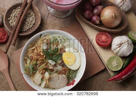 Food Photography, Indonesian Chicken Soto Or Soto Ayam Served With Ketupat Or Lontong, Indonesian Tr