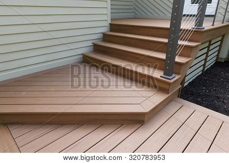 New Modern Front Porch With Metal Railing And Steps