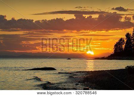 Sunshine Coast Canada Sunset. Roberts Creek Beach At Sunset On The Sunshine Coast Near Sechelt. Bc,