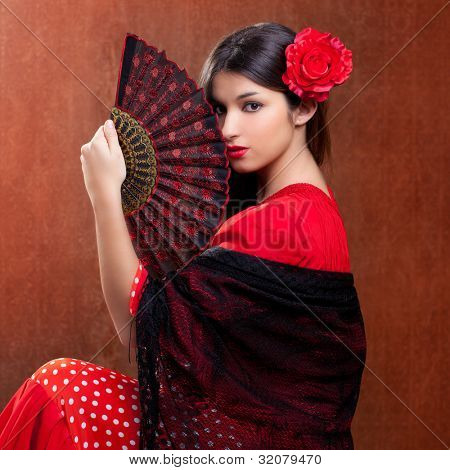 Gipsy flamenco dancer Spain girl with red rose and spanish hand fan