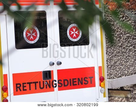 Nuremberg, Germany - August 14, 2019:  Ambulance Writing On The Back Of A German Ambulance Van