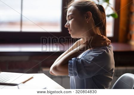 Tired Woman Feeling Pain In Neck Pain After Sedentary Work