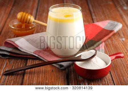 Hot Milk With Butter, Honey And Sodium Bicarbonate, A Folk Remedy For A Strong Cough, With A Bronchi