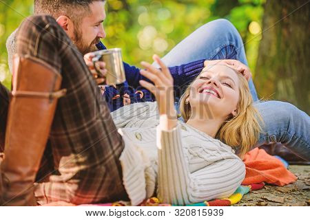 Cheerful Couple. Couple In Love Relax In Autumn Forest With Tea Or Coffee. Camping And Hiking. Happy