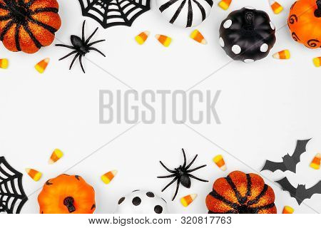 Halloween Double Border Of Pumpkins, Candy And Decor. Flat Lay Over A White Background With Copy Spa