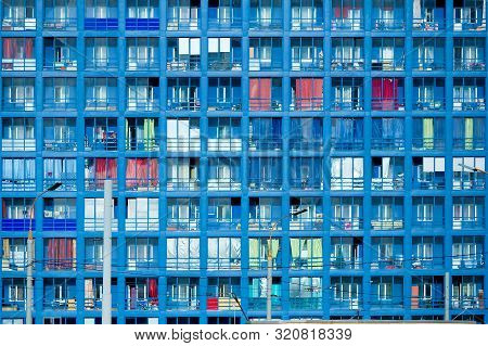 Multiple Exposure Photo Of Multistory Building Fragment Reflecting Blue Sky. Structural Glass Wall W