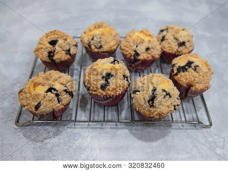 Closeup Of Homemade Blueberry Muffins Cooling On The Rack.