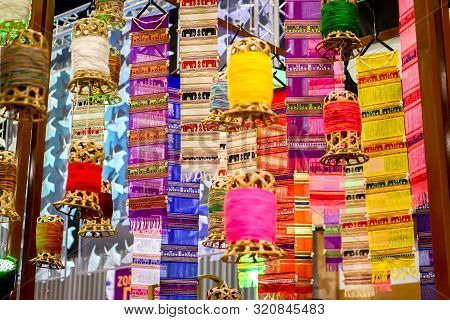 Closeup Decorative Wicker Lantern And Lanna Fabric Long Flags (tung) Hang On Hotel Lobby Ceiling And