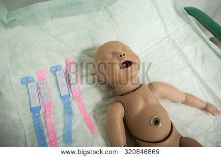 Details With A Plastic Dummy Representing A Newly Born Baby Used By Medics And Midwives For Childbir