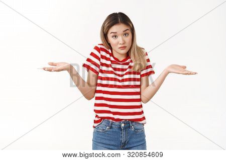 Shit Happens. Unaware Confused Young Silly Puzzled Asian Girl Friend Shrugging Hands Spread Sideways