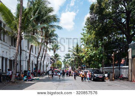 Jakarta, Indonesia - January 2, 2019: View Of People Walking And Enjoying On The Kota Tua Street, Ol