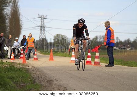 A Cyclist And Traffic Controllers