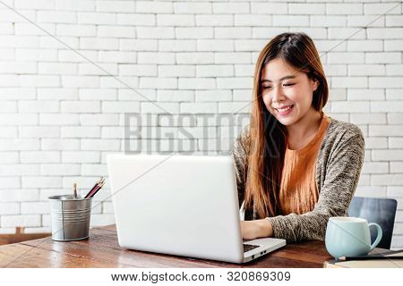 Happy Young Freelancer Woman Working On Computer Laptop In Cozy House, Modern Lifestyle Of New Gener