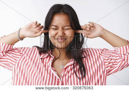 Girl Having Fun Closing Ears And Eyes Squinting And Pulling Smile As Prepared For Loud Bang From Fir