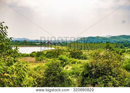 Landscape Of Thailand. Green Nature. Green Landscape With A Lake, A House And Palm Trees.