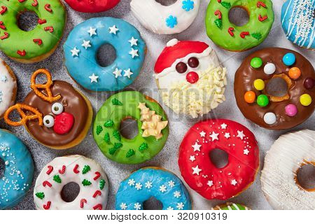 Set Of Christmas Donuts On Gray Stone Background. Christmas And New Year Celebration Concept. Top Vi