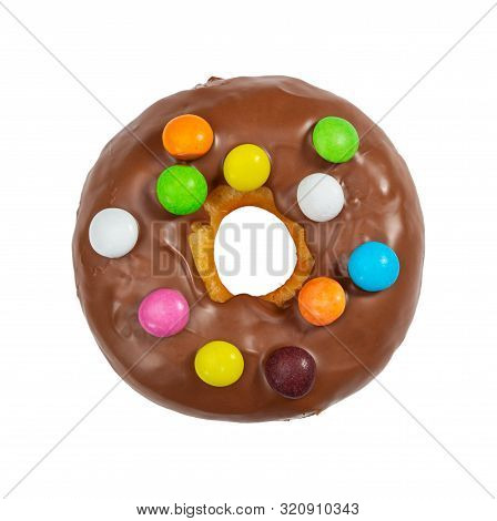 Chocolate Donut With Colorful Candies Isolated On White Background. Top View.
