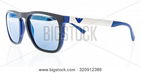 Wnneconne, Wi - 4 September 2019:  A Pari Of Armani Emporio Polarized Sunglasses On An Isolated Back