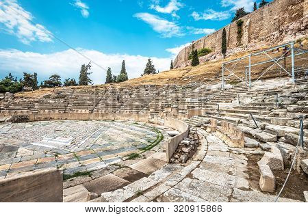 Ancient Greek Ruins At The Foot Of Acropolis, Athens, Greece. Panorama Of Theatre Of Dionysus In Sum