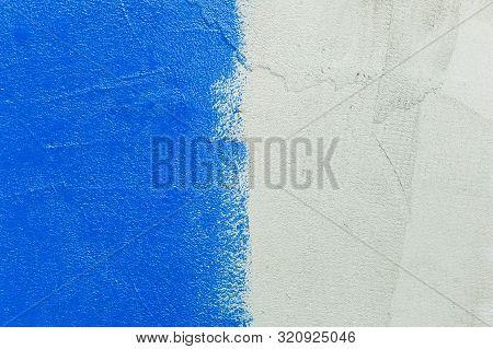 The Texture Of The Gray Draft Wall, Which Is Half Painted With Bright Blue Paint With An Inaccurate