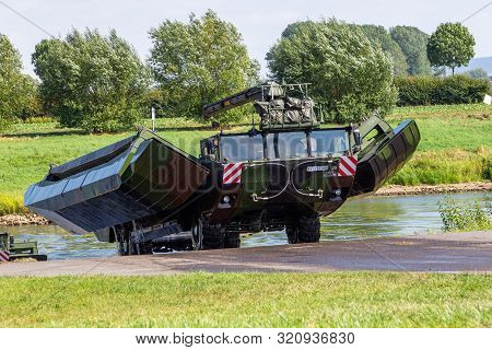 Minden / Germany - September 4, 2019: German Tank Pioneer Battalion Trained A Tank Crossing Over A R
