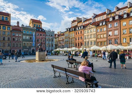 Warsaw, Poland - July 2019: Architecture Of The Old Town And Visitors In Warsaw City In Summer, Pola