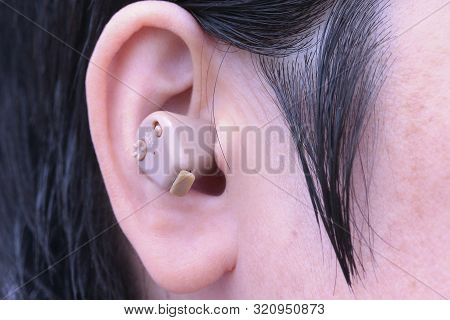 Small Hearing Aid Put In The Right Ear.