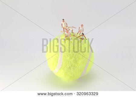 Tiny Toys Play Tennis On The Big Tennis