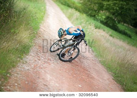 Mountain biker stopped having problem with chain of his bicycle