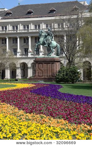 Budapes, Kossuth square: colorful flowerbed and the equestrian statue of the national hero Francis II R���¡k���³czi with the famous motto: