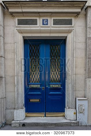 Paris / France - 06 26 2019: Vintage Entrance And Door Windows With Matte Glass Protected By Rhombus