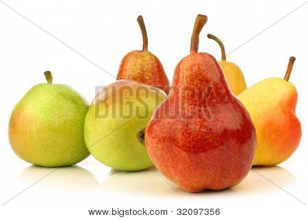 Assortment of different colorful pears with a red bartlett pear in front on a white background