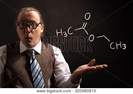 Professor Presenting Handdrawn Chemical Formula Of Ethyl Acetate
