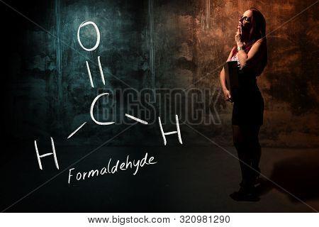 Sexy Girl Or Secretary Or Female Student Presenting Handdrawn Chemical Formula Of Formaldehyde