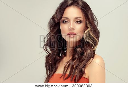 Beautiful  Brunette Model  Girl  With Long Curly  Hair . Hairstyle Wavy Curls . Red  Lips And  Nails