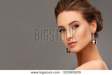 Beautiful Girl . Fashionable And Stylish Woman In Trendy Jewelry Big Earrings .  Fashion Look  , Bea