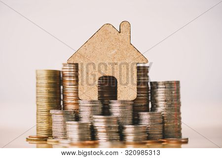 House And Coins Stack For Saving To Buy A House. Property Investment And House Mortgage Financial Co