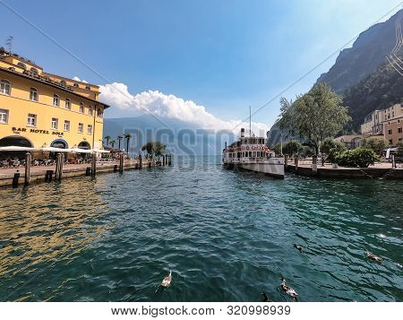Riva Del Garda, Italy -  Aug 1, 2019: An Old Paddle Steamer Boat Docked At The Harbour In Riva Del G
