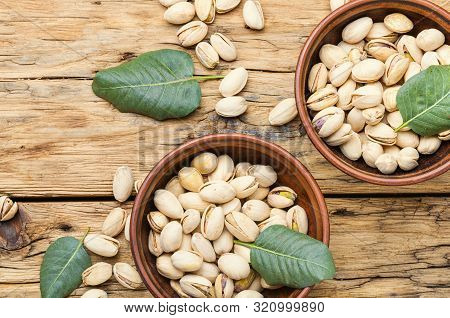 Pistachios Nuts On Wooden Table