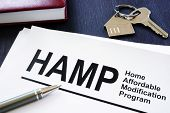 Stack of Home Affordable Modification Program HAMP documents. poster