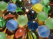 A macro view of various colorful marbles. poster