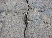 Crack in Grey Concrete Wall Background Isolated with Fissures poster