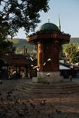 sarajevo capital of bosnia in europe, old city center historical fountain and popular travel destination poster